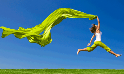Woman Jumping with green scarf