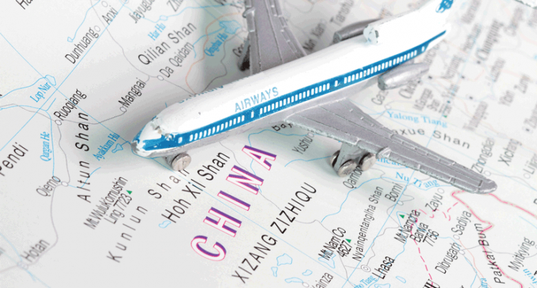 Toy airplane on map of China
