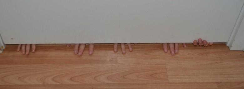 hands under door