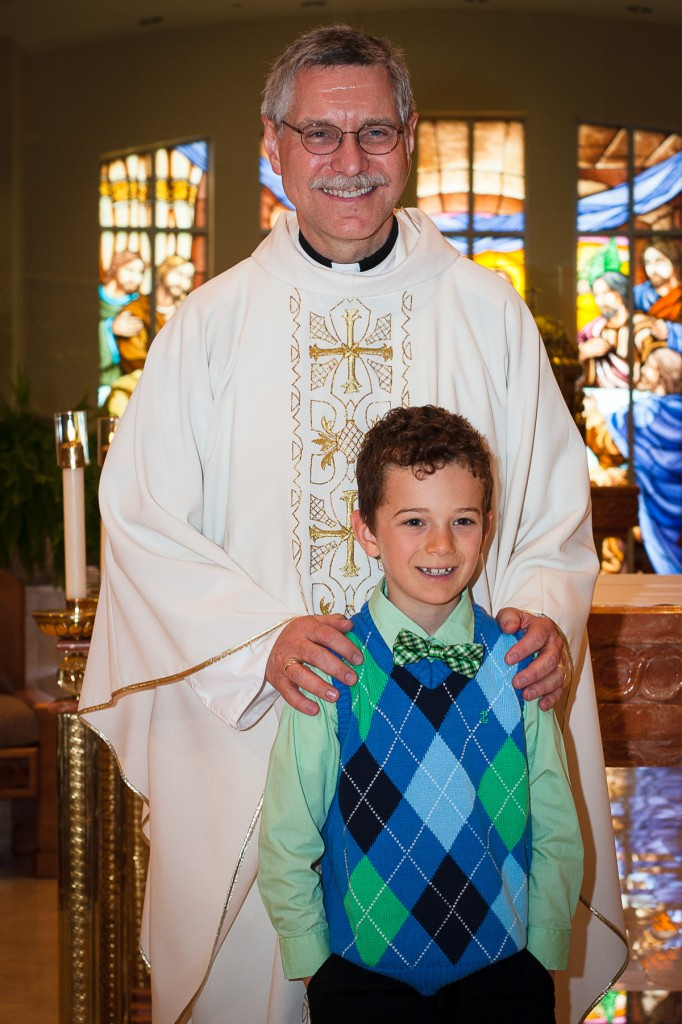 Alex and Fr. Wencil at 1st Communion